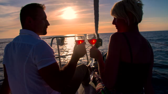 MS Couple Toasting With Wine On The Bow