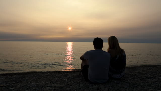 couple together on shore of lake erie - standing water stock videos & royalty-free footage