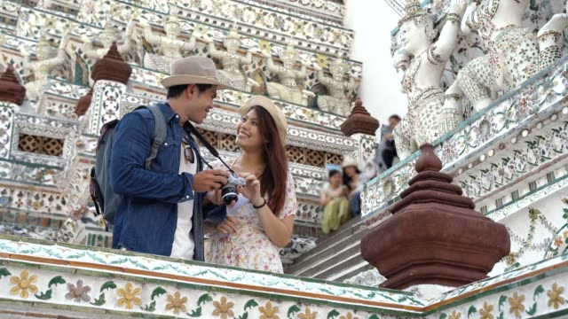 couple tourist traveler at ancient temple - female likeness stock videos & royalty-free footage