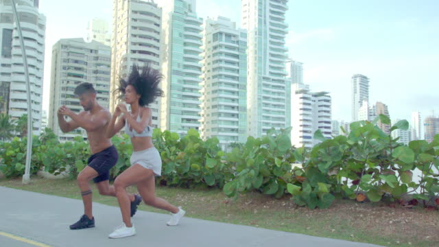 couple training near the beach - colombian ethnicity stock videos & royalty-free footage