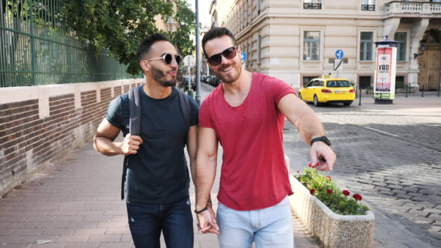 lgbt couple traveling in summer - gay vacations - hungary stock videos & royalty-free footage