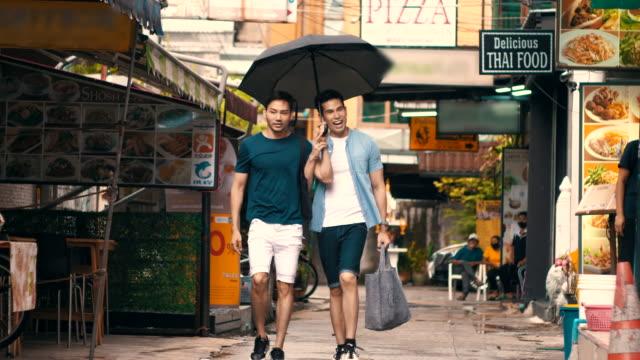 lgbtqi couple travelling in khao san road, bangkok thailand - human rights stock videos & royalty-free footage