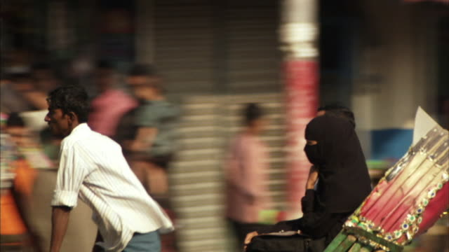 POV, MS, Couple travelling in rickshaw on busy street, Dhaka, Bangladesh