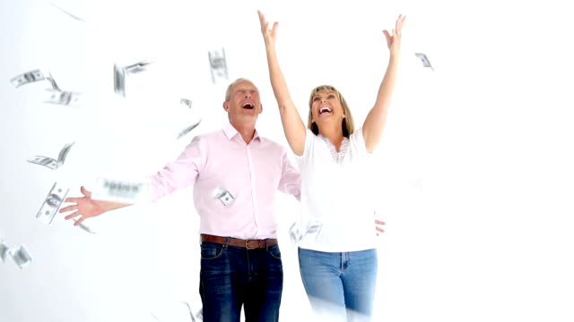 couple trying to grab money falling from the sky on slow motion - winning stock videos & royalty-free footage