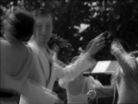 "b/w 1937 cu couple turning + dancing ""big apple"" outdoors while wagging fingers / washington, dc / newsreel - 1937 stock-videos und b-roll-filmmaterial"