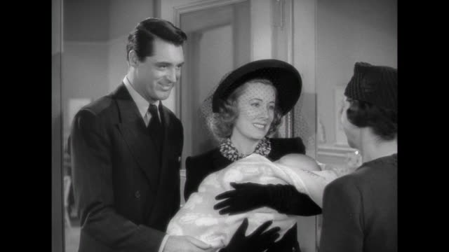 1941 couple ( cary grant & irene dunne) unexpectedly adopt baby girl - adoption stock videos and b-roll footage