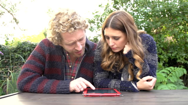 hd dolly: couple using a digital tablet - mid adult couple stock videos & royalty-free footage