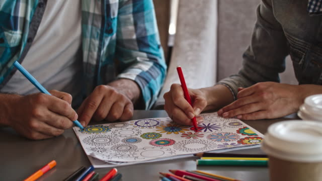 Couple using adult coloring page