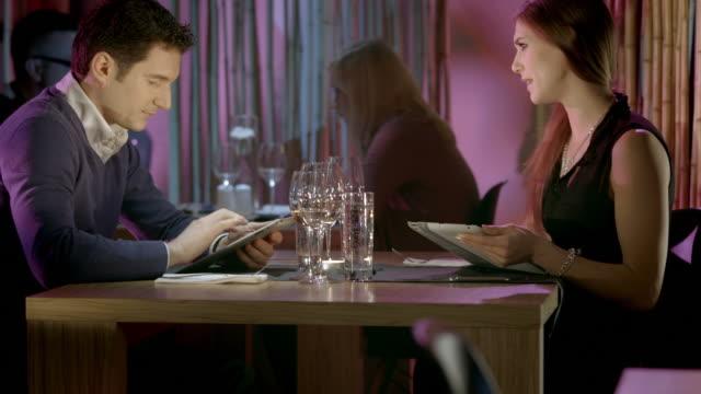 HD DOLLY: Couple Using Digital Card Menues