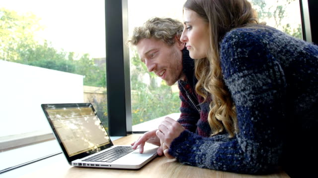 HD: Couple Using Laptop At Home