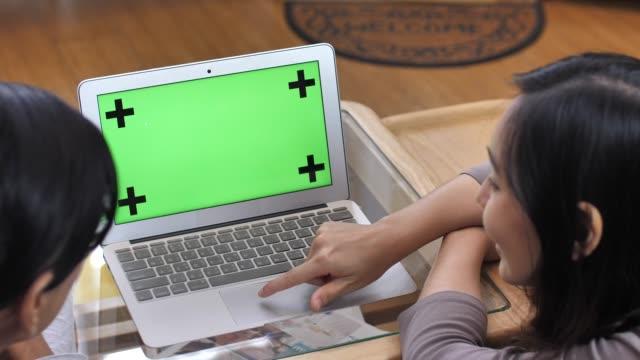 Couple using Laptop Green screen