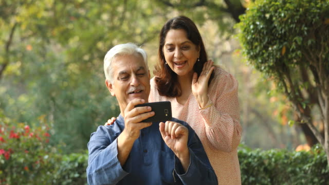 couple using mobile phone for video call - indian ethnicity stock videos & royalty-free footage