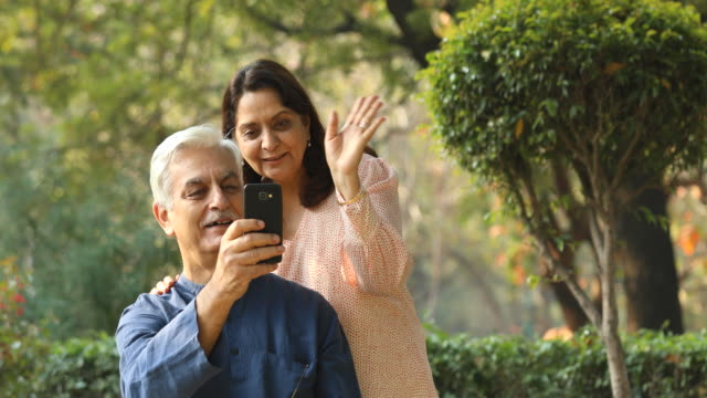 couple using mobile phone for video call - waving stock videos & royalty-free footage