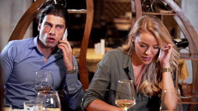 couple using mobile phone while on a dinner - dating stock videos & royalty-free footage