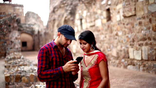 couple using smartphone - 3rd century bc stock videos & royalty-free footage