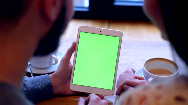 couple using tablet with green screen during coffee break - shoulder stock videos and b-roll footage