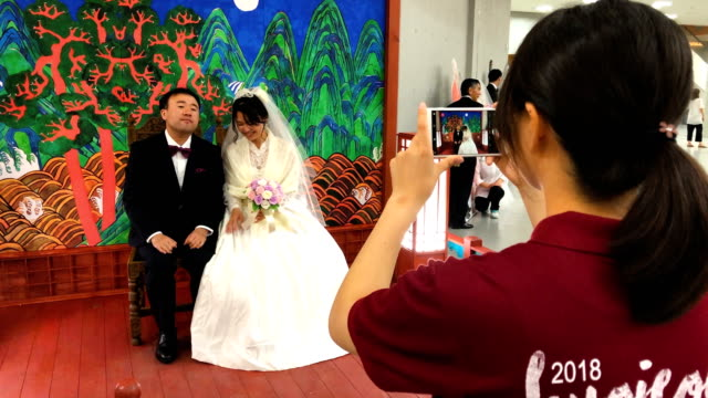 couple wait for their wedding ceremony of the family federation for world peace and unification, commonly known as the unification church, at... - south korea couple stock videos & royalty-free footage