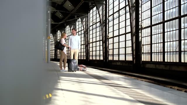 Couple waiting at station