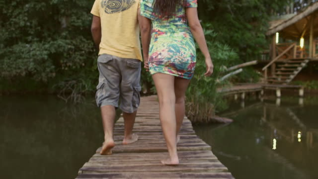 TS A couple walk on a boardwalk together / Maringa, Brazil