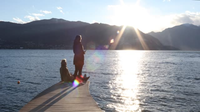couple walk onto lake pier, they look out to view - see other clips from this shoot 56 stock videos & royalty-free footage