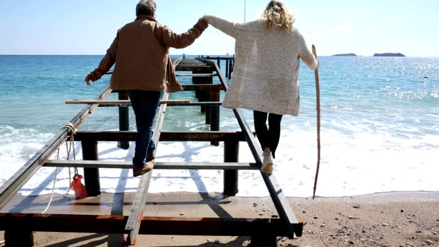 couple walk onto pier platform above sea, surf - mediterranean turkey stock videos and b-roll footage