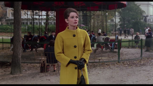 1963 couple (cary grant and audrey hepburn) walk slowly through busy park searching - audrey hepburn stock videos & royalty-free footage