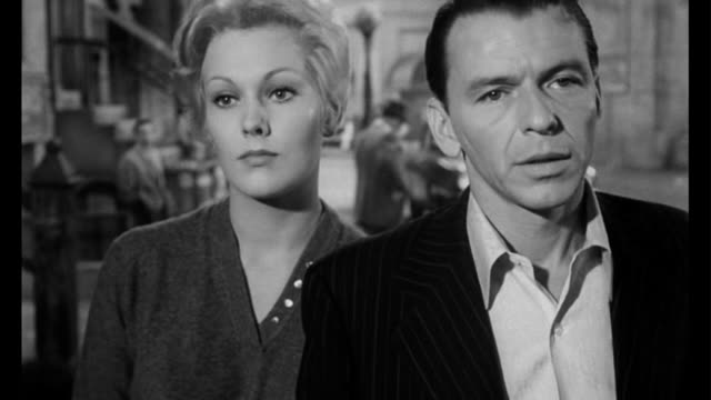 stockvideo's en b-roll-footage met 1955 couple (frank sinatra and kim novak) walk the streets of chicago - 1955