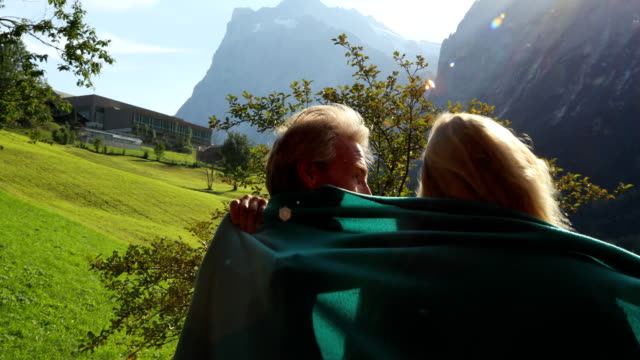 couple walk through doorway, look out to mountains - shawl stock videos and b-roll footage
