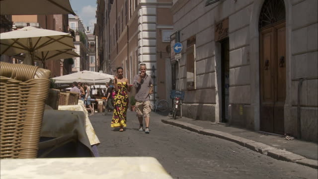 ws couple walking along street, rome, italy - street food stock videos & royalty-free footage
