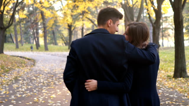 couple walking and hugging - two people stock videos & royalty-free footage