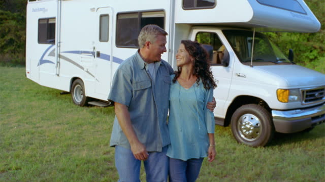 ms ts couple walking arm in arm away from parked motor home / asheville, north carolina, usa - 50 54 jahre stock-videos und b-roll-filmmaterial