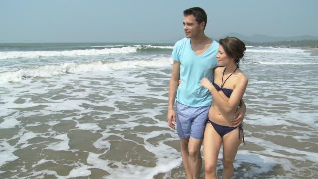 Couple walking by sea