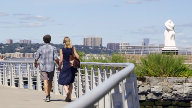 couple walking by the hudson river - jackson new jersey stock videos and b-roll footage