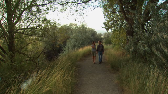 couple walking down a trail