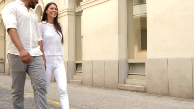couple walking down the city street - ethnicity stock videos & royalty-free footage