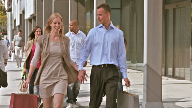 DS Couple walking down the shopping precinct