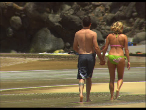 couple walking hand in hand on beach - see other clips from this shoot 1158 stock videos & royalty-free footage
