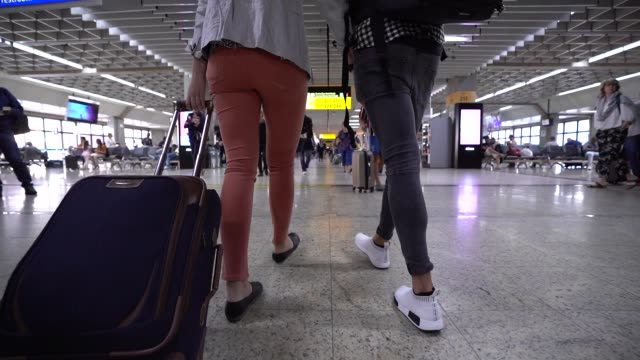couple walking in airport - airport terminal stock videos & royalty-free footage