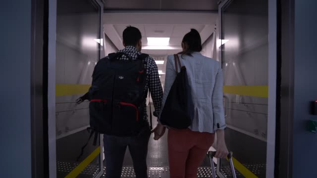 couple walking in airport - tourism stock videos & royalty-free footage