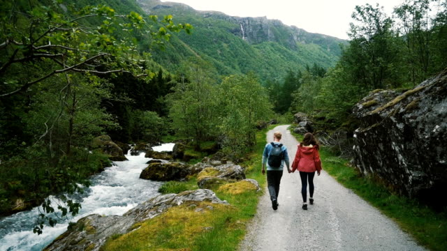 Couple walking in countryside in Norway