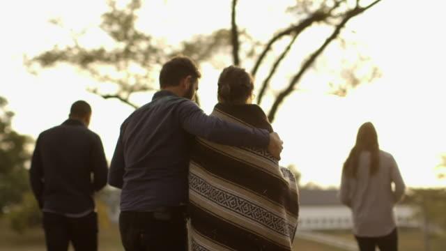vídeos y material grabado en eventos de stock de couple walking in rural field - manta ropa de cama
