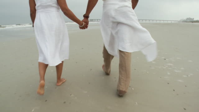 MS POV Couple walking on beach / Jacksonville, Florida, USA