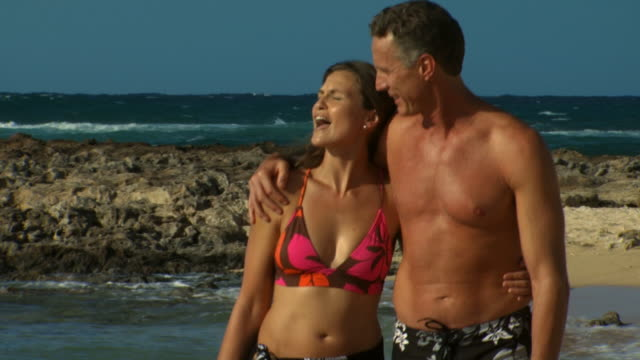 couple walking on beach smiling - see other clips from this shoot 1142 stock videos & royalty-free footage