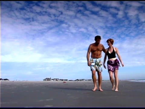 couple walking on beach - see other clips from this shoot 1335 stock videos and b-roll footage