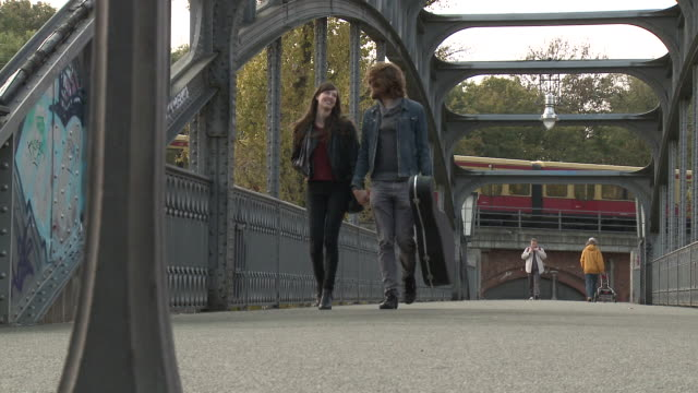 MS Couple walking on bridge / Berlin, Germany