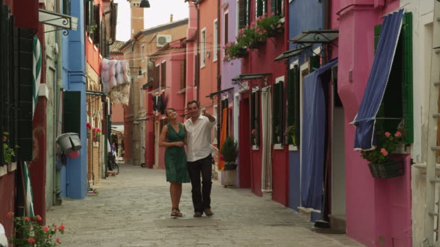 ws couple walking on narrow street of old town / murano - old town stock videos & royalty-free footage