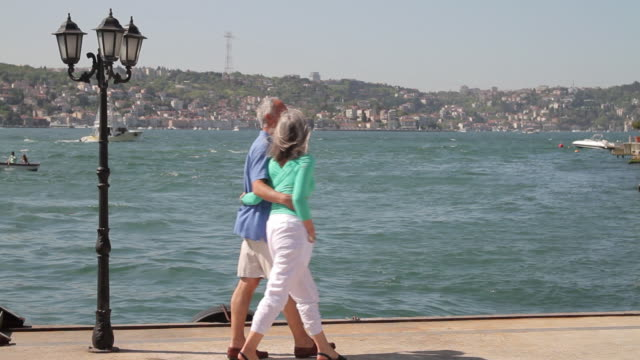 couple walking on promenade at the bosphorus river turkey, istanbul - tourist stock videos & royalty-free footage