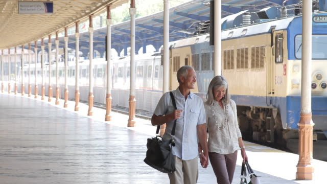 couple walking on rail station platform, holding hands, istanbul turkey - städtereise stock-videos und b-roll-filmmaterial