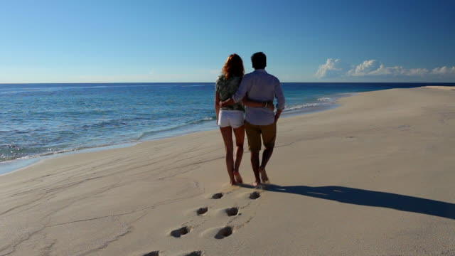 couple walking on the beach - bahamas stock videos & royalty-free footage