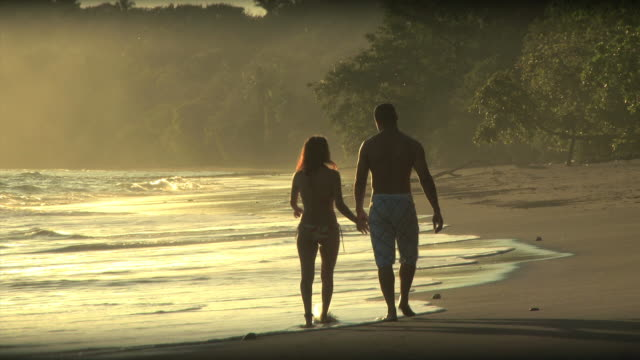 couple walking on the beach - see other clips from this shoot 1157 stock videos & royalty-free footage